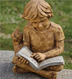 Reading Boy Statue shows a bright boy enjoying the magic that can be found in the pages of a book!