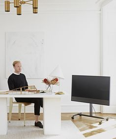 The founder of Kinfolk Magazine Nathan Williams in his studio with BeoVision Horizon, designed to bring uncompromising minimalism that makes it blend in and complement any interior.