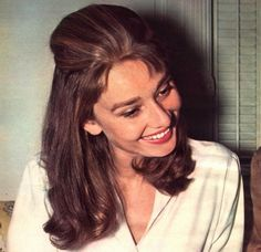 Smiling Audrey Hepburn during filming of Breakfast at Tiffany's 1961.  She enjoyed having this caramel blonde streaks to her brown hair for the role of Holly Golightly and decided to keep them off screen as well during making of Breakfast at Tiffany's 1961.