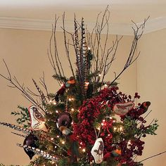 Feathered Tree Topper - Add a natural feel to your Christmas decorating by tucking long faux pheasant feathers (available at most crafts stores) into the top of the tree. The addition of red berries and a few bird ornaments will have guests flocking to see this woodsy tree. A few hidden clips can help keep the pieces in place.