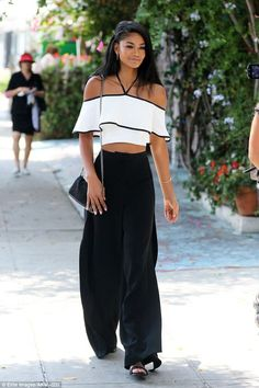Ruffling their feathers in a good way: Chanel Iman showcased her toned midriff…
