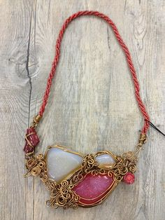 Brass wire necklace with natural stones and beaded strap by Oscar Daniel
