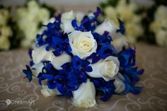 Blue and white rose bridal bouquet photographed before a wedding ceremony at Moon Palace Golf & Spa Resort in Cancun, Mexico. Photo courtesy of #DreamArtPhotography.