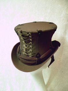 Goth meets sci-fi in this sexy custom made chocolate canvas lace-up top hat. #steampunk #goth