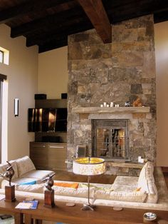Rustic Living Room with High ceiling, Sierra Foyer Table in Ash, stone fireplace, Exposed beam, Built-in bookshelf