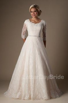 The Windham | This darling modest wedding ball gown features a creamy color, darling ¾ illusion lace sleeves and a cinched beaded belt at the natural waist.     Gown available in Creme Brulee/Ivory, Ivory/Ivory or White/White    *Gown pictured in Creme Brulee/Ivory     Sleeve length or neckline can be customized.  Please call for more information.    Available at LatterDayBride.com or in Store Located in Salt Lake City, Utah