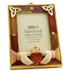 Claddagh Photo Frame - 4 x 6 - made by a process known as Intarsia which is the ancient art of making pictorial mosaics by laying precious and exotic woods onto a solid wood surface. Seven different woods are used to make these Celtic designs, $38.95. Kelly and Nick's Wedding Picture?
