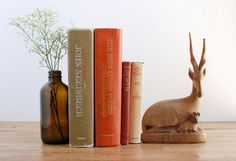 This is a stunning mid century wooden antelope and baby figurine. This piece is made of smooth finely carved wood and is crafted with beautiful