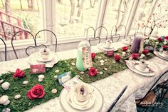 Gorgeously appointed party table from Wonderland Birthday Party at Kara's Party…