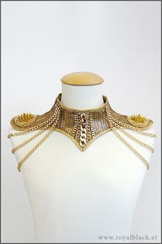 Pure Gold Neck Corset by Royalblack  Glamourous neck corset made from golden sequin fabric. It is decorated with golden chains and mini epaulettes with spikes, Swarovski crystals and shoulder chains.