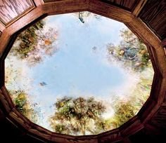 Mural on a nine foot dome in a walnut paneled library. Perfect for reading in a dark quiet room with the ceiling opening up to fruit trees, birds and sky.