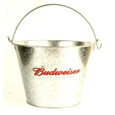 "Officially Licensed Galvenized Budweiser Ice Bucket Drink Holder by RTSI. $14.99. Great for theme parties, tailgates, the beach or any get together. Holds approximately 6-7 bottles of your favorite beverage plus ice. Sturdy handle for ease in carrying. Pail is 7 1/4"" Tall. It has a Base diameter of 6 3/4"" and a Top diameter of 7 1/4"". Features the iconic Budweiser official logo. This party pail features a beautiful design on the front and back of the outside of ..."