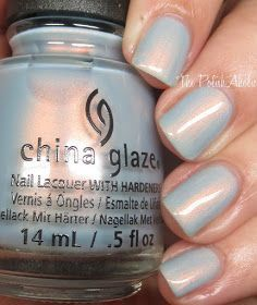 China Glaze: ❤️ Pearl Jammin' ❤️ ... a light blue nail polish with a coppery orange flash of shimmer (which stands out nicely) from the Fall 2016 Rebel Collection