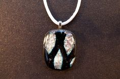 Light pink and black patterned dichroic glass pendant from Ivy Tree Designs. $18.60