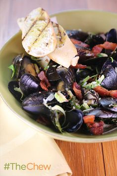 Fancy up your weeknight dinner with Michael Symon's seafood feast of Mussels with White Wine & Garlic. #TheChew