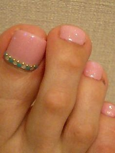 Simple pink pedi with jade and white detailing.