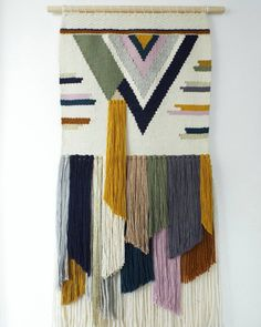 "Finished this beauty today!   Inspired by mid century modern art  measures 17"" x 37"" lots of angles and lots of colour  #geometric #weaving #fiberart #cylcollective"