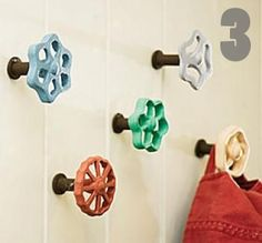 These old faucet handles can be found at just about any antique supply store. These old guys double can easily double as coat hooks; just paint them in funky colors and mount them to the wall. hang coat hangers on them, and purses over the handles