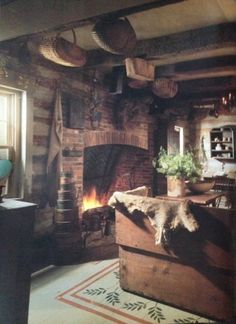 cozy by the fire in log cabin