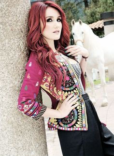 Dulce María (full name: Dulce María Espinosa Saviñón, born: December 6, 1985, Mexico City, Mexico) is a Mexican actress, singer and songwriter. She's been part of several music projects, most notably pop group RBD from 2004 to 2009, which originated from the successful telenovela Rebelde (2004–2006), and sold 57 million albums around the world. Since 2009, after signing to Universal Music, Dulce María has released two solo albums: Extranjera (2010) and Sin Fronteras (2014).
