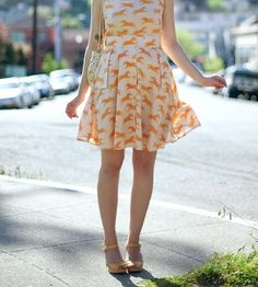 Patterned with a whimsical print of leaping zebras, this orange and peach skirt can certainly punch up any white tee. The flowy A-line shape is draped to flatter, with a wide flat waistband and foldover flap pockets. It closes with a series of matching buttons that travel from waist to hem.
