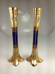 Elegant pair of Bohemian vintage cobalt blue enamelled glass with porcelain decorations tall vases