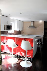 Clean streamlined kitchen with a pop of color.