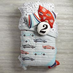 A racecar bedding set wouldn't be complete without speedsters, racing stripes or classic pit stop tools. Luckily, The Land of Nod's Pit Crew Bedding has them all. The quilt has embroidered details and even reverses to a solid color. The sheet set is made from soft cotton and features lively prints of roadside favorites. Designed exclusively for Nod by Dustin Wallace.