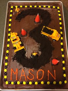 "For a construction themed party: 12 x 18 x 2 sheet pan, 3 boxes of yellow cake mix, baked for 50 minutes at 325. Used crumbled oreos for the ""3""."