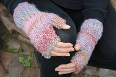 ***Get through everyday tasks seamlessly while looking winter wonderland perfect. Keep your hands cozy while driving, texting, handling money, touching up lipstick, holding on to that little ones hand, when wearing these gorgeous gloves.  ***We call this fabulous yarn Sugarplum. The shades of pink, purple, burgundy & mauve have a blue tone and a copper metallic thread running throughout. Pictures dont capture how beautiful it truly is.  ***Chunky knit with shaping at wrist and fingers…