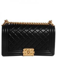 This is an authentic CHANEL Lambskin Quilted Medium Boy Flap in Black. This chic shoulder bag is crafted of luxurious lambskin leather.