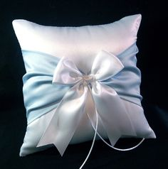For Troy:  Light Blue Accent  White Wedding Ring Bearer Pillow. $18.00, via Etsy.