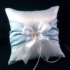 For Troy:  Light Blue Accent  White Wedding Ring Bearer Pillow. $18.00, via Etsy.