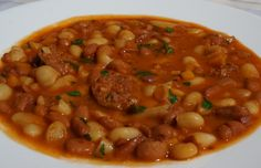 Croatian Bean and Sausage Soup - a hearty peasant soup or stew that gets its flavor from smoked sausage and paprika.
