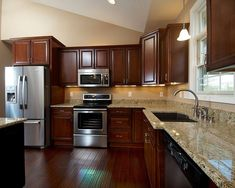 alexandria gourmet kitchen with cherry cabinets love the cabinet color not counters not handles - Cherry Cabinets