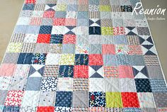Add hourglass blocks randomly to interrupt a patchwork squares quilt.
