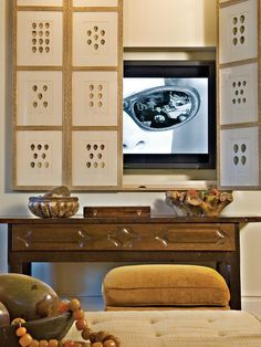 I like the cover for the tv for the more formal living room. cover it up while entertaining