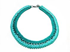 Items similar to Crochet and pompoms chain necklace in shades of turquoise on Etsy Shades Of Turquoise, Beaded Bracelets, Necklaces, Pom Pom Trim, Mint Color, Thread Crochet, Silver Color, Turquoise Bracelet, Chain