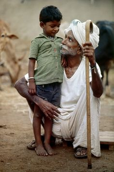 kafiristan: Looking Across Generations in Hyderabad by United Nations Photo. A grandfather in the Banjara tribal community showers his affection on a young boy near Hyderabad, India.Photo ID Hyderabad, India. UN Photo/John Isaac. We Are The World, People Around The World, Hyderabad, Beautiful Children, Beautiful People, A Well Traveled Woman, Tribal Community, Village Photography, Landscape Photography