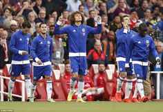 Chelsea's David Luiz looks to the heavens as he emerges from the tunnel before the hotly-anticipated Premier League clash