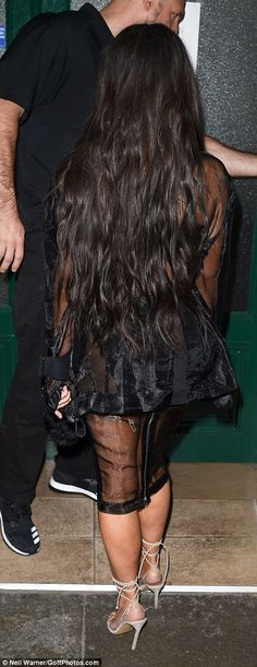 The 35-year-old was leaving the Balmain offices on Tuesday with her entourage when Vitalii slipped past security and tried to tackle her - appearing to try to kiss her famous behind.