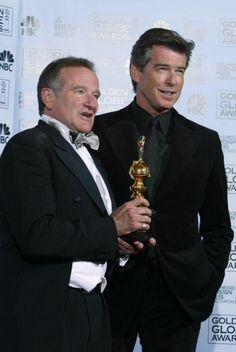 US actor Robin Williams holds his Cecil US actor Robin Williams holds his Cecil B. DeMille Award with award presenter British actor Pierce Brosnan at the 62nd annual Golden Globe Awards show 16 January 2005 in Beverly Hills. AFP PHOTO/HECTOR MATA/AFP/Getty Images