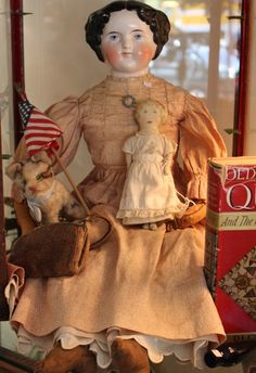 Large China doll, cloth doll, and Steiff critter