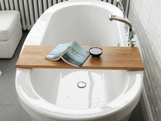 free standing bath with strong costume built tray i can transfer onto