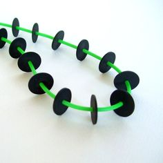 green and black necklace, bright color, eco friendly, recycled plastic and rubber long single strand necklace,  urban chic, funky fashion,