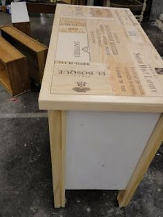 wine crate panels used to retop a dresser!!