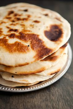 Indian Cuisine: Garlic Naan (leavened, and oven-baked flatbread).