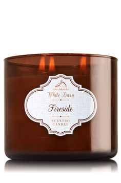 "Fireside - 3-Wick Candle - Bath & Body Works - The Perfect 3-Wick Candle! Made using the highest concentration of fragrance oils, an exclusive blend of vegetable wax and wicks that won't burn out, our candles melt consistently & evenly, radiating enough fragrance to fill an entire room. Candle comes in beautiful colored glass with a silver lid! Burns approximately 25 - 45 hours and measures 4"" wide x 3 1/2"" tall."