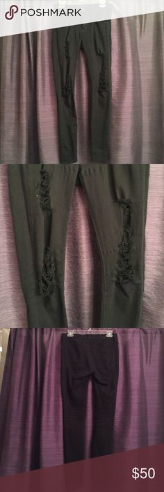 Express midrise black ripped skinny jeans Express size 4 Mia mid rise black skinny jeans. Destroyed on knees and thighs. In great condition! Gently used. Perfect for fall! Very stretchy and comfy. Come just at/above the belly button Express Jeans Skinny