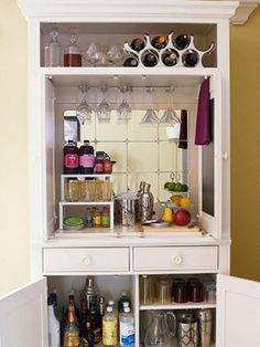Organizing Tips That Actually Work Entertainment center to bar. Could do this in our front room if we don't find a piece to put in dining room!Entertainment center to bar. Could do this in our front room if we don't find a piece to put in dining room! Bar Armoire, Corner Armoire, Dresser Bar, White Armoire, Corner Tv, Do It Yourself Furniture, Diy Bar, Organizing Your Home, Organizing Tips